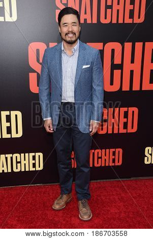 LOS ANGELES - MAY 10:  Randall Park arrives for the 'Snatched' World Premiere on May 10, 2017 in Westwood, CA