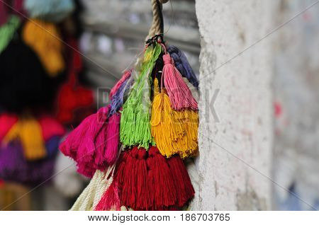 Colorful string yarn tassles for sale at a shop in the city of Guangzhou China.
