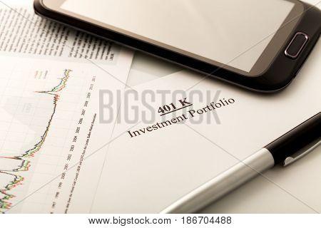 Retirement calculator chart crop mobile phone pen investment