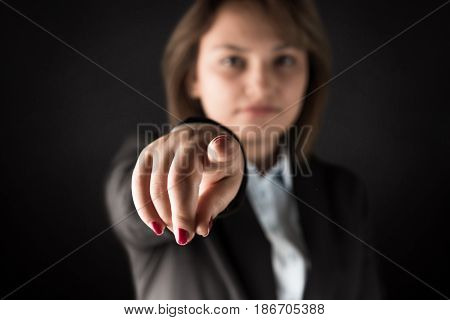 Business woman points his finger at you