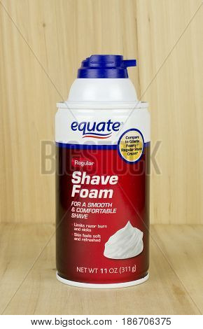 RIVER FALLS,WISCONSIN-MAY 16,2017: A can of Equate brand shaving cream with a wood background.
