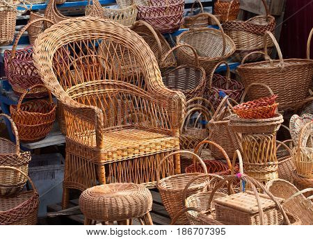 Wicker furniture and wicker baskets of different shapes and colors