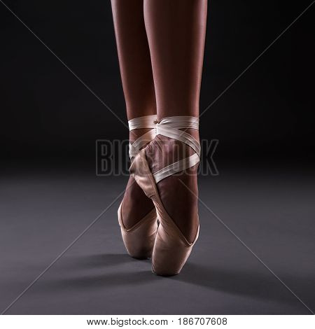Close Up Of Ballerina Legs In Pointes