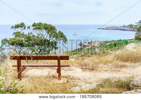 Bench in the park Cavo Greco in Ayia Napa overlooking the Mediterranean Sea. Cyprus