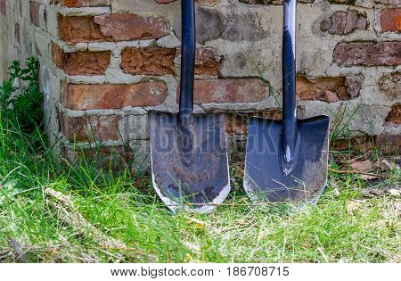 Two metal shovels compact reliable and multifunctional can often come in handy in nature