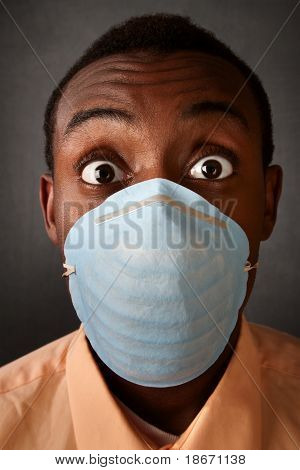 Wide-eyed Man In Surgical Mask