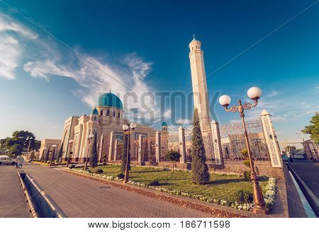 Beautiful Mosque (Islamic temple) at sunset over blue sky wide angle photo