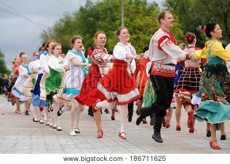 Orel Russia - May 9 2017: Victory Day selebration. People in Russian costumes dancing in roundelay on square