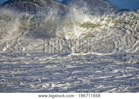 Wave crashing at Ipanema beach in Rio de Janeiro