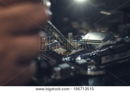 Computer processor. Technician works with CPU unmount from motherboard.