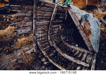 old wooden boat boat with a cortex. The tree rotted and collapsed. Concept fishing for fish on the white sea in Russia.