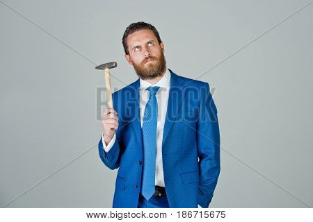 Determined Businessman With Hammer In Hands, Business And Success