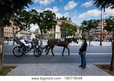 Palermo, Italy - October 14, 2009: Horse Cart In Background The Politeama Garibaldi Theater