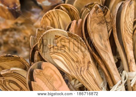 Kitchen utensils from olive wood. Traditional Cretan souvenirs. Greece.