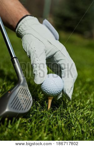 Close-up golf ball golf ball on tee golf tee activity leisure golf club