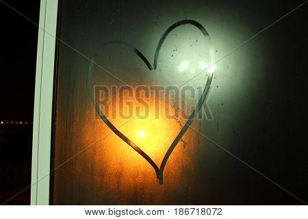 The Illuminated Heart on the sweaty window