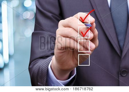Businessman Hand Checking The Checking Box .