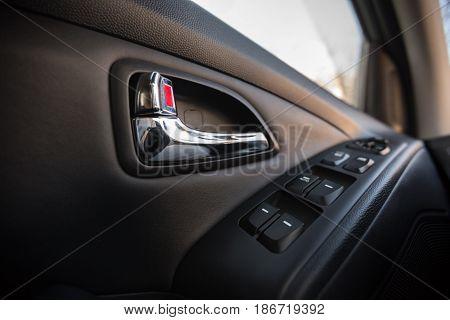 Car window closeup knob lock opening luxury