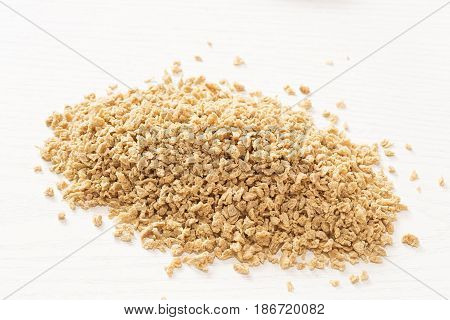 The heap of the soy flakes on white background