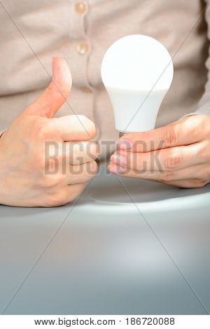 Female Hands Holding A Glowing Led Light And Show Like