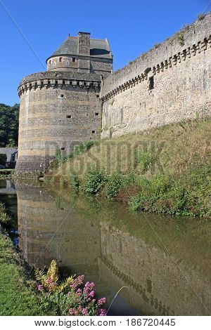 Fougeres castle walls reflected in the moat