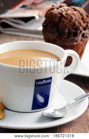Cup Of Lavazza Coffee And Muffin