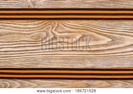 Two St. George ribbons on a wooden background