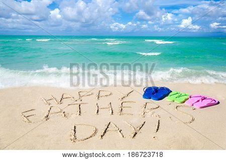 Happy father's day background with flip flops on the Miami beach near the ocean Florida