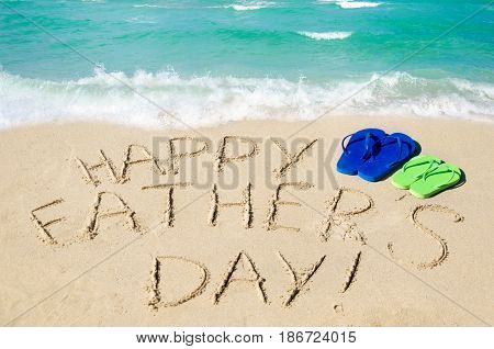 Happy father's day background with flip flops on the Miami sandy beach near the ocean Florida