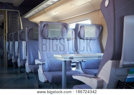 MOSCOW, JUL,12, 2010: Interior view on passenger saloon interior first class seats chairs of high speed train Pendolino Sm6 ALLEGRO. High speed train interior passenger seats chairs Russian high speed