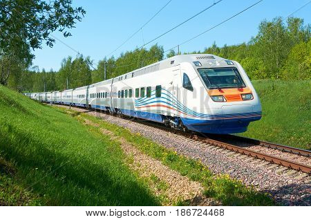 MOSCOW, RUSSIA, JULY 12, 2010: High speed train Pendolino Sm6 ALLEGRO runs on the railway test ring. White high speed train on Moscow rail ways RZD. High speed train ALLEGRO Russian Railways