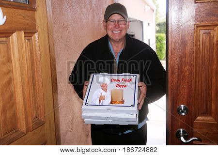 PIZZA Delivery at your home or office. Isolated on white. Room for text. Pineapple, Ham, Pizza for lunch.