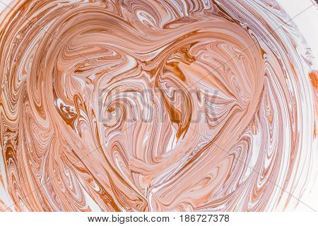 Mixing brown colour with a bright white acrylic paint. Mix liquid paint. Abstract texture with contours of the heart.