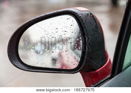 Raindrops On Side Rear View Mirror In Rain