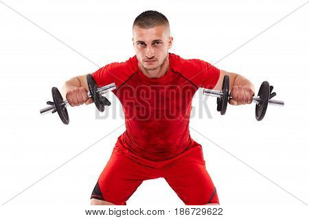 Young man training deltoids with dumbbells isolated on white poster
