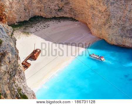 Beautiful view on Shipwreck beach in amazing bay, boats and ships with swimming people in Ionian Sea blue water, Blue Caves. Greece islands Zakynthos Navagio beach sightseeing holidays vacations