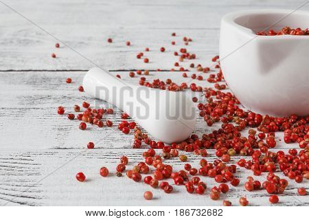 Red Peppercorns Close Up On Old Wooden Background
