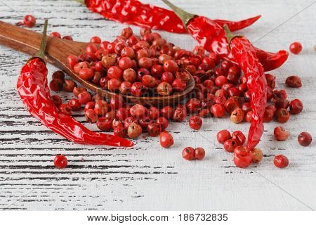Red Peppercorns Close Up With Wooden Spoon