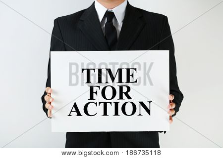 Businessman Holding Sheet Of Paper With Word Time For Action