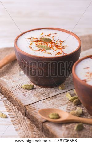 Traditional Indian Lassi Curd With Cardamon And Saffron.