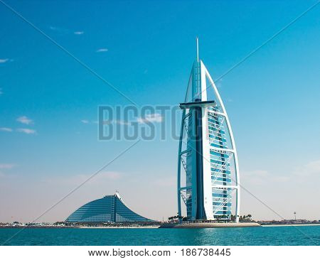 DUBAI UAE - January 2015: Two luxury hotels Burj Al Arab and Jumeirah Beach Hotel in Dubai. Back side of hotels view from sea