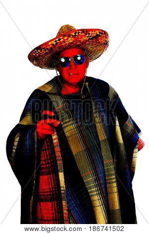 A man wears a Mexican Sombrero, a Serape or Poncho sunglasses and smokes a big cigar as he celebrate a Mexican holiday or tradition. Isolated on white, Room for text.   Colorized for a unique image.