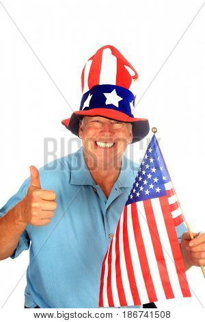 A handsome patriotic man wears an American Flag Hat, holds an American Flag and gives the Thumbs Up sign. Isolated on white. Room for text.