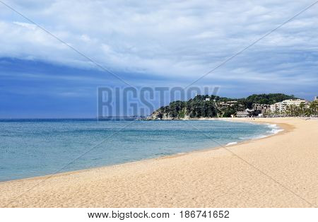 a view of Platja de Lloret beach in Lloret de Mar, the main beach of this popular tourist village in the Costa Brava, in Catalonia, Spain