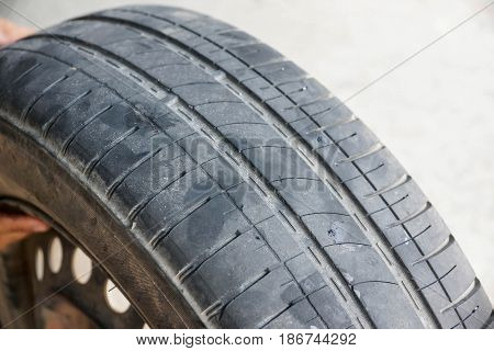 Worn out car tire tread / Danger of using old car tire with low tread depth concept