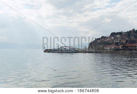 OHRID, MACEDONIA - MARCH 12, 2017: Ship moored near the pier of Ohrid lake