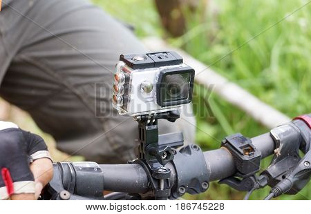 Digital camera installed on a handlebar of a mountain bike