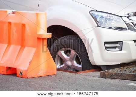 Wheel of a truck fall into a manhole / Road accident concept