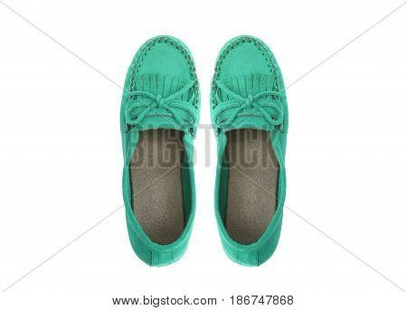 A pair of cyan moccasins isolated on white