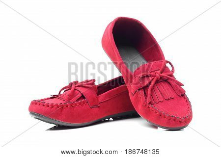 A pair of red moccasins isolatedon white